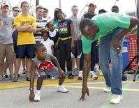 <p>Jamaican world record holder Usain Bolt (R) lines up with Omari Welch, 6, of Randolph, Mass. during a promotional event in Boston, Massachusetts in this recent photo from April 26, 2009. REUTERS/Greg M Cooper</p>