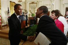 <p>President Barack Obama (L) greets a participant in an event on helping small businesses recover from the economic crisis, in the East Room of the White House in Washington in this March 16, 2009 file photo. As the severe recession in the United States chills activity in most industries, many small business owners like Vanessa Baug are refusing to give in, determined to fight to the bitter end. REUTERS/Jason Reed/Files</p>