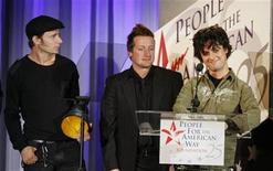 <p>Members of the band Green Day (L-R) Mike Dirnt, Tre Cool and Billie Joe Armstrong accept their award at the 25th Anniversary Spirit of Liberty Awards presented by the People for the American Way in Beverly Hills, California October 10, 2006. REUTERS/Fred Prouser</p>