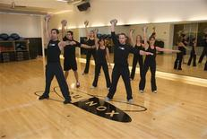 <p>Instructor teaches kettlebell class at Equinox Fitness in Chicago, Illinois in this 2009 file photo. REUTERS/Eric Hiffhines/Handout</p>