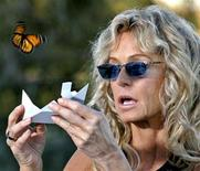 <p>Actress Farrah Fawcett releases a live Monarch butterfly in commemoration of comedian Rodney Dangerfield's one year anniversary death at the comedian's home in West Hollywood, California in this file photo from October 5, 2005. REUTERS/Staff</p>