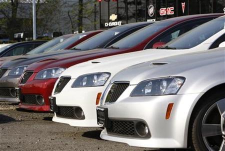 Pontiac G8 sedans sit on a lot for sale at a General Motors auto dealership in Nanuet, New York, April 27, 2009. REUTERS/Mike Segar