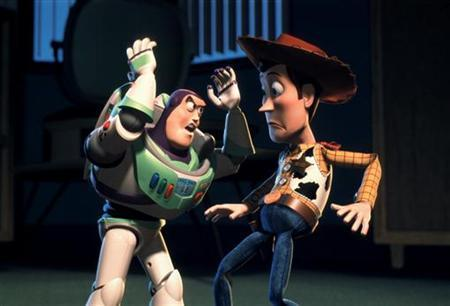 In a handout photo from November, 1999, Buzz Lightyear (L) is forced to remind his pal '' Woody'' that he is a toy, a child's plaything after Woody discovers that he is a highly valued collectible in Disney/Pixar's animated comedy adventure film ''Toy Story 2.'' REUTERS/Handout/File