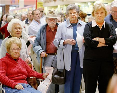 A line up at a Virginia super market in a file photo. REUTERS/Larry Downing