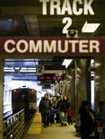 <p>Passengers get off a commuter train at North Station in Boston, Massachusetts, April 3, 2004. REUTERS/Brian Snyder</p>