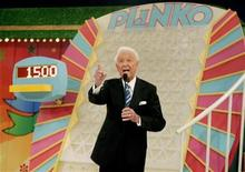 "<p>Host Bob Barker introduces the ""Plinko"" game segment during the taping of his final episode of the game show ""The Price Is Right"" in Los Angeles June 6, 2007. REUTERS/Fred Prouser</p>"