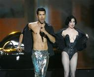 <p>Oscar Loya (L) of Germany's Alex Swings Oscar Sings performs with Burlesque dancer Dita Von Teese during a rehearsal for the Eurovision Song Contest final in Moscow May 15, 2009. REUTERS/Sergei Karpukhin</p>