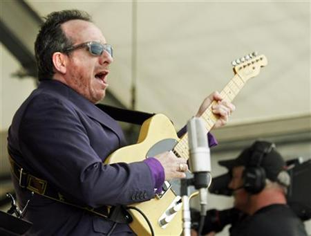 Elvis Costello performs during the New Orleans Jazz and Heritage Festival in New Orleans in this file photo from April 30, 2006. REUTERS/Lee Celano