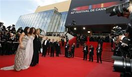 "<p>Tunisian model Afef Jnifen (C), Dutch model Doutzen Kroes (R) and U.S. actress Evangeline Lilly arrive for the screening of the film ""Vengeance"" at the 62nd Cannes Film Festival May 17, 2009. REUTERS/Eric Gaillard</p>"
