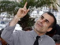 "<p>Director Bahman Ghobadi poses during a photocall for the film ""Kasi Az Gorbehaye Irani Khabar Nadareh"" at the 62nd Cannes Film Festival May 15, 2009. REUTERS/Jean-Paul Pelissier</p>"