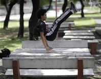 <p>A Parkour practitioner leaps over a picnic table in a public park in Marikina, metro Manila May 9, 2009. REUTERS/John Javellana</p>
