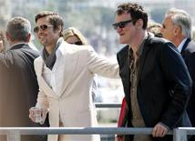 """<p>Director Quentin Tarantino (R) and cast member Brad Pitt leave a photocall for the film """"Inglourious Basterds"""" at the 62nd Cannes Film Festival May 20, 2009. REUTERS/Vincent Kessler</p>"""