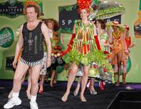 "<p>TV personality Richard Simmons (L) leads a parade of models dressed in clothing adorned with fruit and vegetables, both real and faux, during a ""summer salad fashion show"" at New York's Grand Central Terminal June 2, 2006. REUTERS/Wish-Bone/Ray Stubblebine/Handout</p>"