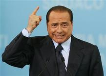 <p>Italy's outgoing Prime Minister Silvio Berlusconi gestures at the opening of Letizia Moratti's mayoral electoral campaign in Milan May 7, 2006. REUTERS/Daniele La Monaca</p>