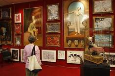 <p>A visitor stands near artwork of late French mime Marcel Marceau and presented on the eve of an auction in Paris on May 25, 2009. REUTERS/John Schults</p>