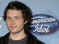 "<p>Finalist Michael Johns from Buckhead, Georgia poses at the American Idol Top 12 party honoring the finalists in the ""American Idol"" television reality series in Los Angeles, California March 6, 2008. REUTERS/Fred Prouser</p>"
