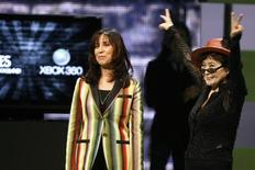 """<p>Olivia Harrison (L), widow of George Harrison, and Yoko Ono, widow of John Lennon, introduce the new video game """"The Beatles: Rock Band"""" at the Microsoft XBox 360 E3 2009 media briefing in Los Angeles June 1,2009. REUTERS/Fred Prouser</p>"""