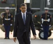 <p>U.S. President Barack Obama boards Air Force One at Dulles International Airport in Virginia before departing to Saudi Arabia, June 2, 2009. REUTERS/Larry Downing</p>