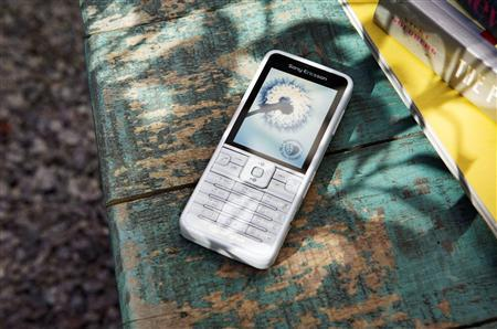 A low-energy Sony Ericsson C901 GreenHeart mobile phone made partially from recycled materials is seen in this undated handout photo released June 4, 2009. REUTERS/Sony Ericsson/Handout