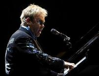 """<p>Britain's Elton John performs during his show """"The Red Piano"""" at La Bombonera stadium in Buenos Aires January 22, 2009. REUTERS/Marcos Brindicci</p>"""