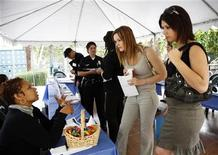 <p>Sof'a Mac'a (L), Human Resources Specialist with the City of West Hollywood, California, talks with Sydney Dupree (C), 23, and Jaklyn Fior (R), 24, both transgenders, during a job fair held by the Transgender Economic Empowerment Project (TEEP) at the L.A. Gay & Lesbian Center in Los Angeles, California June 5, 2009. REUTERS/Jason Redmond</p>