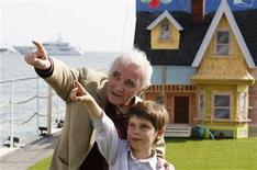 """<p>French singer Charles Aznavour (L) and voice actor Tom Trouffier point in unison on a pier during a photocall for the animated film """"Up"""" by director Peter Docter at the 62nd Cannes Film Festival May 13, 2009. REUTERS/Regis Duvignau</p>"""
