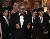 """<p>Musician Elton John (C) accepts the Tony for best musical for """"Billy Elliot, The Musical"""" as stars of the musical (L-R) David Alvarez, Trent Kowalik and Kiril Kulish look on at the 63rd annual Tony Awards ceremony in New York, June 7, 2009. REUTERS/Gary Hershorn</p>"""