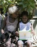"""<p>Un alunno aborigeno usa dell'isola di Elcho, in Australia, un laptop distribuito dalla campagna """"One Laptop Per Child"""". La foto è stata scattata il 27 maggio 2009. REUTERS/James Reagan</p>"""