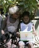 """<p>An Australian aboriginal school child works on a laptop computer as part of the """"One Laptop Per Child"""" program in Elcho Island May 27, 2009. REUTERS/James Reagan</p>"""