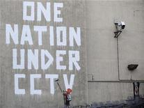 <p>Street graffiti is seen on a wall, next to a CCTV camera, in central London November 25, 2008. REUTERS/Toby Melville</p>