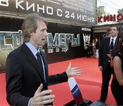 "<p>Director and executive producer Michael Bay gives an interview during the Russian premiere of ""Transformers: Revenge of the Fallen"" at Novy Arbat street in Moscow, June 16, 2009. REUTERS/Mikhail Voskresensky</p>"