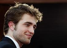 """<p>Actor Robert Pattinson arrives on the red carpet for the screening of the film """"Inglourious Basterds"""" at the 62nd Cannes Film Festival May 20, 2009. REUTERS/Jean Paul Pelissier</p>"""
