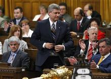 <p>Prime Minister Stephen Harper stands to vote in the House of Commons on Parliament Hill in Ottawa June 19, 2009. REUTERS/Chris Wattie</p>