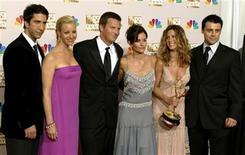 """<p>The cast of """"Friends"""" appears in the photo room at the 54th annual Emmy Awards in Los Angeles September 22, 2002. REUTERS/Mike Blake</p>"""