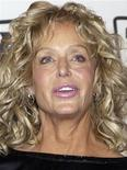 """<p>Actress Farrah Fawcett poses backstage after she was named the Favorite """"Fan""""-tastic Phenomenon for """"Charlies Angels"""" during a taping of the second annual TV Land Awards in Hollywood in this March 7, 2004 file photo. Fawcett died on June 25, 2009 after a long battle with anal cancer, her spokesman said. She was 62. Picture taken March 7, 2004. REUTERS/Jim Ruymen/Files</p>"""