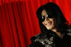 <p>U.S. pop star Michael Jackson gestures during a news conference at the O2 Arena in London in this March 5, 2009 file photo. REUTERS/Stefan Wermuth/Files (</p>