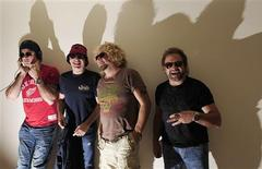 <p>Chickenfoot band members (L-R) Chad Smith, Joe Satriani, Sammy Hagar and Michael Anthony pose for photographs at the Metrapolitan hotel in London June 25, 2009. REUTERS/Nigel Roddis</p>