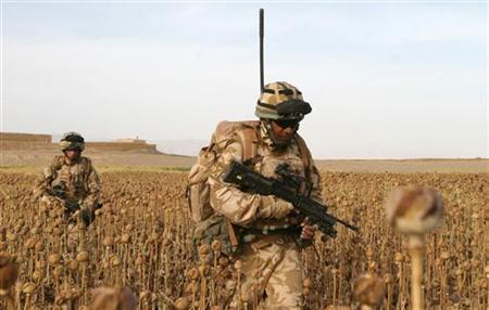 British soldiers from The Black Watch, 3rd Batallion, Royal Regiment of Scotland patrol in a poppy field during an operation in Gereshk District, Helmand province May 6, 2009. REUTERS/Jonathon Burch