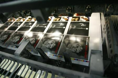 Freshly printed covers of Michael Jackson's 'The Essential' CD are pictured in the Austrian 'ArtPress' factory in Hoefen July 3, 2009. REUTERS/ Dominic Ebenbichler