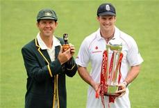 <p>Australia's captain Ricky Ponting (L) with an Ashes urn replica and England's captain Andrew Strauss with the npower trophy pose before the first Ashes Test at Cardiff, Wales July 7, 2009. REUTERS/Philip Brown</p>