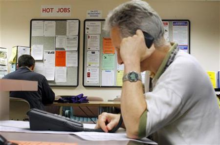A job seeker makes a phone call to a potential employer at The Work Place, which provides comprehensive employment and career services in Boston, Massachusetts July 2, 2009. REUTERS/Brian Snyder
