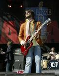 <p>Nic Cester of the Australian band Jet performs at the Live 8 concert in Barrie, Ontario July 2, 2005. REUTERS/STR New</p>