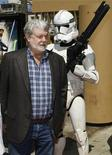 "<p>George Lucas, the executive producer of the new animated film ""Star Wars: The Clone Wars"", poses a Storm Trooper character at the film's U.S. premiere in Hollywood, California August 10, 2008. REUTERS/Fred Prouser</p>"