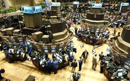 Traders work on the floor of the New York Stock Exchange, July 24, 2009. REUTERS/Brendan McDermid