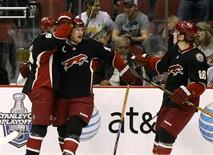 <p>Phoenix Coyotes Shane Doan (C) celebrates with Kyle Turris (L) and Peter Mueller after scoring in the second period against the Vancouver Canucks during an NHL game in Glendale, Arizona, March 21, 2009. REUTERS/Rick Scuteri</p>