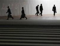 <p>Pedestrians in Tokyo's central business district in a file photo. REUTERS/Kim Kyung-Hoon</p>