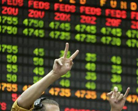 A trader in a file photo. REUTERS/File