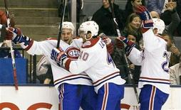 <p>Montreal Canadiens Guillaume Latendresse (L) celebrates his first period goal against the Toronto Maple Leafs with team mates Maxim Lapierre (C) and Josh Gorges in their NHL game in Toronto April 4, 2009. REUTERS/Fred Thornhill</p>