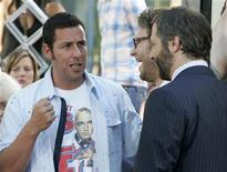 "<p>Actor Adam Sandler (L) stands next to co-star Seth Rogen and director Judd Apatow (R) at the premiere of their new comedy film ""Funny People"" in Hollywood July 20, 2009. REUTERS/Fred Prouser</p>"