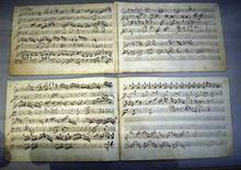<p>Two newly discovered pieces of music by Wolfgang Amadeus Mozart are seen for the first time in public in a house where the master composer once lived, in Salzburg August 2, 2009. REUTERS/Calle Toernstroem</p>